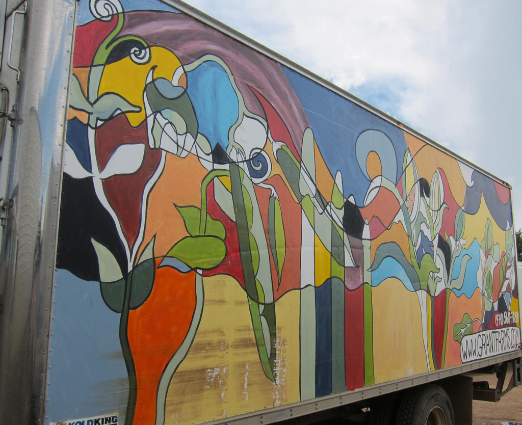 "Chris Bates, ""Special Delivery"" Acrylic on Fiberglass Truck, 12'x40', Mural on a delivery truck for Grant Family Farms, Wellington,  CO."
