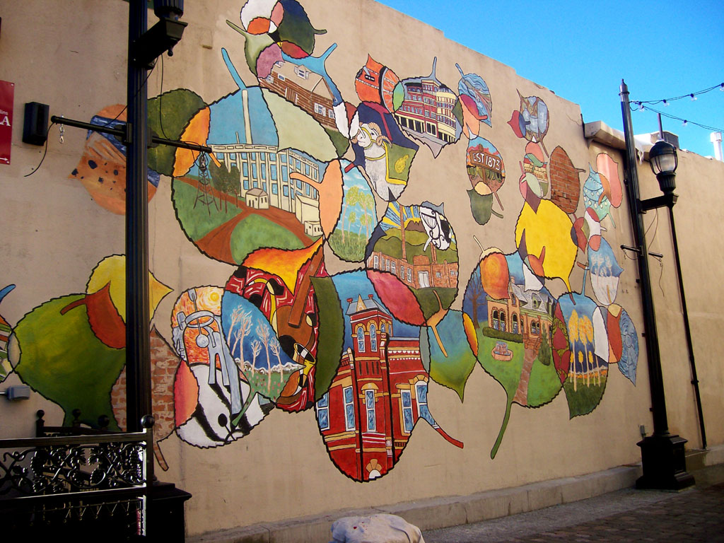 "Chris Bates, ""Hard To Leave"", 2010, Acrylic on stucco, 24'x36', Mural in Tenney Alley, Downtown Fort Collins, CO."